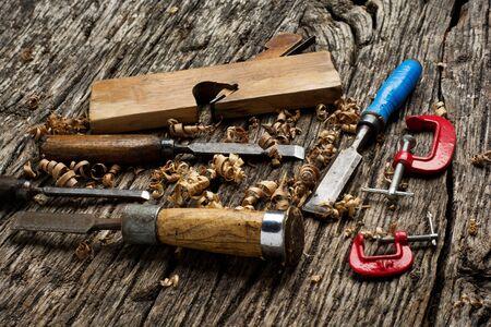 carpenter tools on dark wooden pine wood table
