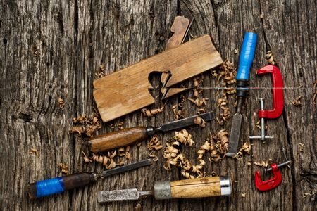 Old carpenter tools on rustic wood table top view