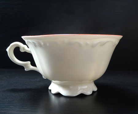 Tea cup porcelain old fashion white with black background