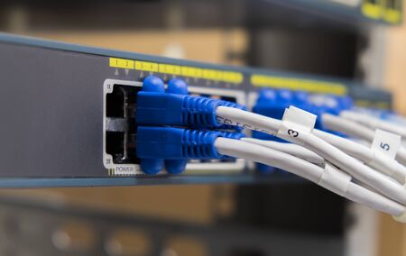 utp: Lan utp cable plug in network switch Stock Photo