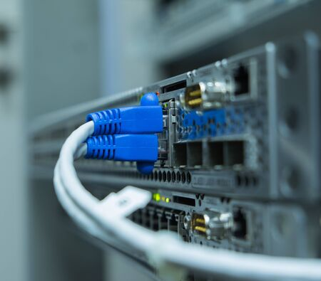 switch plug: Lan utp cable plug in network switch Stock Photo