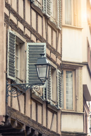 fachwerk: Street view and lamp with alsace building Strasbourg,France vintage with sun flare