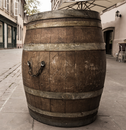 wine road: Old wodden wine barrell on road at Strasbourg,Alsace,France vintage style