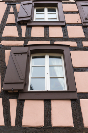 fachwerk: Old french window decorate in alsace  ,France Stock Photo