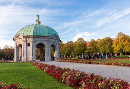 city park pavilion: Munich - Oct 24 : Hofgarten in autumn with blue sky. Hofgarten Court Garden is a garden in the center of Munich, Germany,