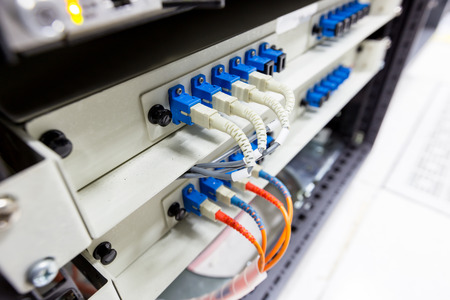 rack mount: Fiber optic cable connect to ethernet switch mount on rack