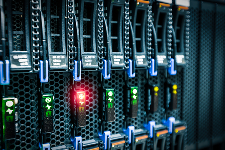 rack mount: Computer Server mount on rack in data center room with red lighting alarm.