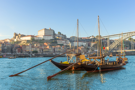 Porto old town wine port skyline with douro river and traditional Rabelo boat, Portugal
