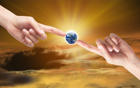 Hand with earth globe isolated on sun light background, ecology concept Stock Photo - 10430238