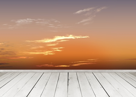 Wooden terrace looking out over a tropical cloud sky Stock Photo - 10430228
