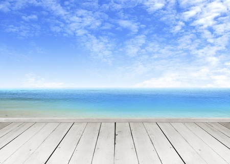 wood pillars: Wooden terrace looking out over a tropical cloud sky and seaview