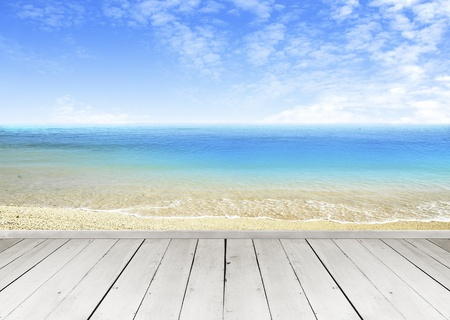 banister: Wooden terrace looking out over a tropical cloud sky and seaview