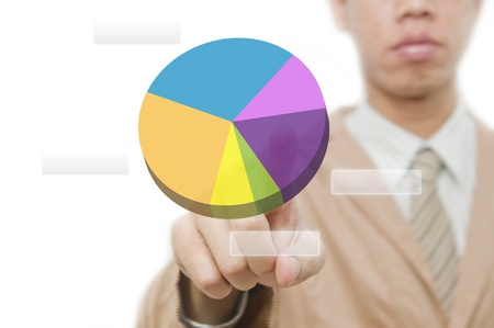 Businessman point finger on pie chart touch screen  Stock Photo - 10430062