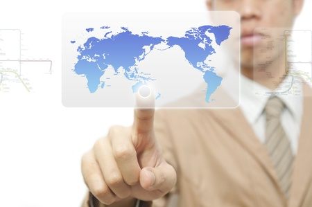 Business man finger pressing a worldmap touchscreen button with index finger on australia Stock Photo - 10430255