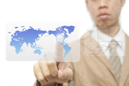 Business man finger pressing a worldmap touchscreen button with index finger on north america photo