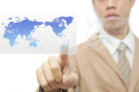 worldmap: Business man finger pressing a worldmap touchscreen button with index finger on south america