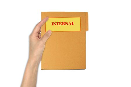 confidentiality: Hand holding internal paper folder Stock Photo