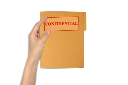 conputer: Hand holdingconfidential paper folder Stock Photo