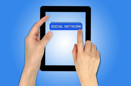a male hand holding a touch screen, Social network concept with people photos in world map background photo