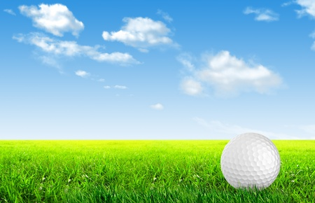 golf swing: Close-up of golf ball with green grass for web design background