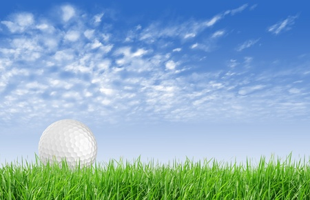 Close-up of golf ball with green grass and blue sky for web design background  photo