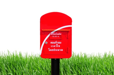 Red thailand post box on green grass and white background photo