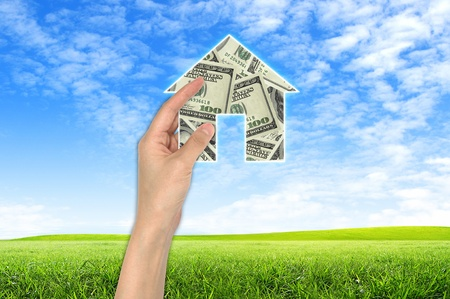 The House and hands with blue sky as a symbol of the real estate business.  photo