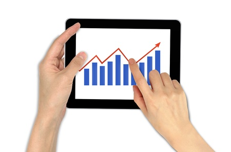 Hand with graph and touchscreen device showing business and investment concept photo