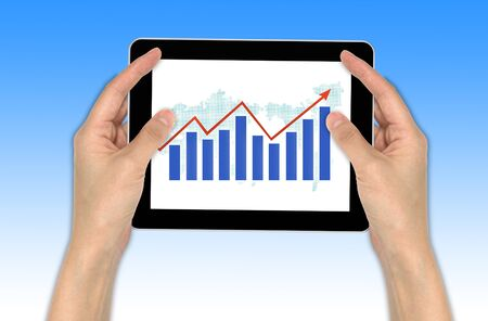 Hand with graph and touchscreen device showing business and investment concept Stock Photo - 10430057