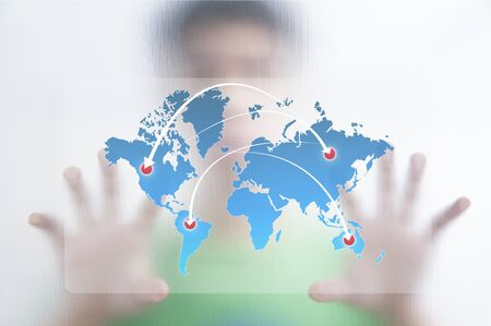 Businessman point finger on world map with ARROW Stock Photo - 10473688
