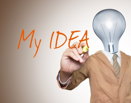 Young businessman with lamp-head and marker writting something on screen Stock Photo - 10473477