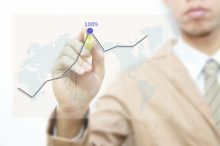 Young business man drawing graph on the transparent screen photo