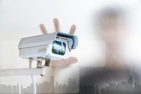 Security Camera or CCTV on digital background Foto de archivo