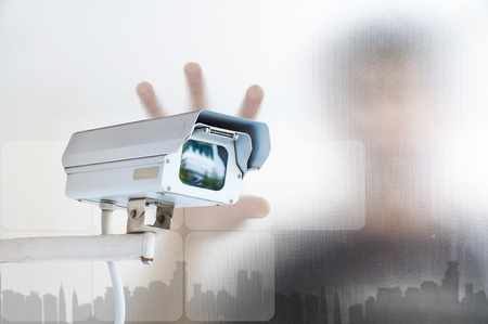 Security Camera or CCTV on digital background Stock Photo - 10473781