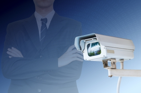 alarm system: Security Camera or CCTV on digital background Stock Photo