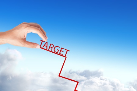 hand catch target red graph over the blue background photo