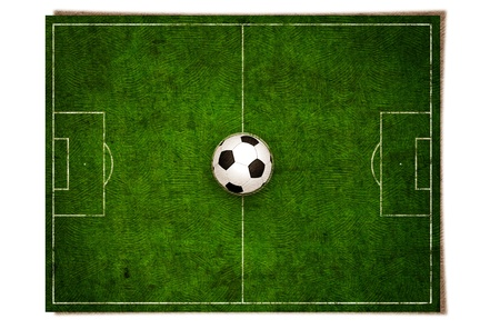 gree grass football field on vintage texture paper photo