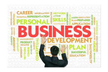 A business man climb business words on white jigsaw wall photo