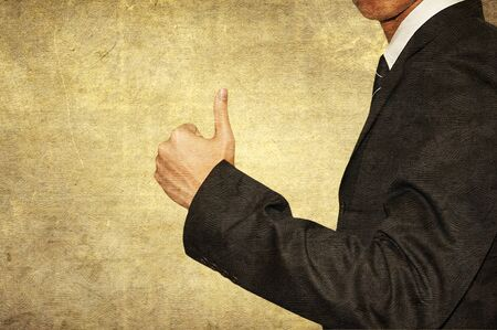 Businessman show thumb up on retro style photo