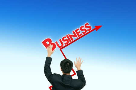 A business man placing business words on the blue sky,growth photo