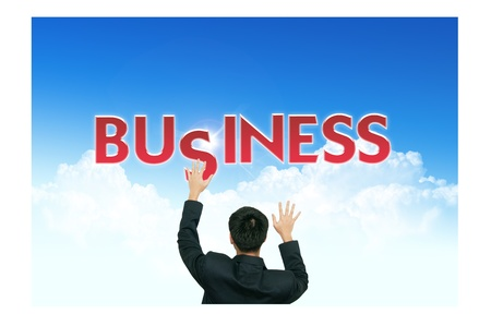 A business man climb business words on blue sky background photo