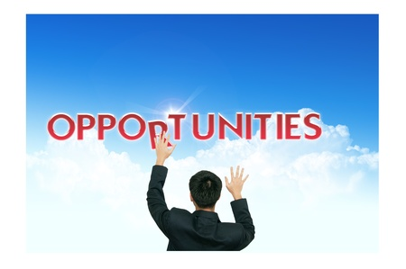 opportunity sign: A business man climb business words on blue sky background