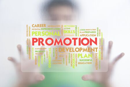 hand tag: Man pushing the business word cloud on transparent screen,promotion