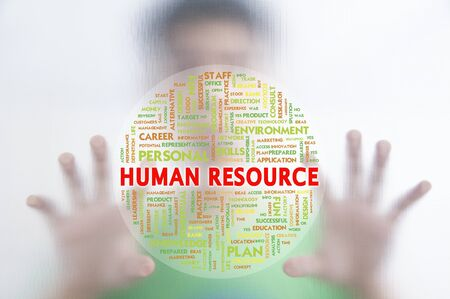 instances: Man pushing the business word cloud on transparent screen,human resource