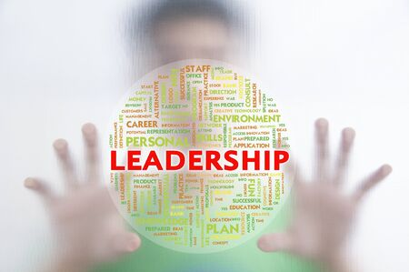 instances: Man pushing the business word cloud on transparent screen,LEADERSHIP Stock Photo