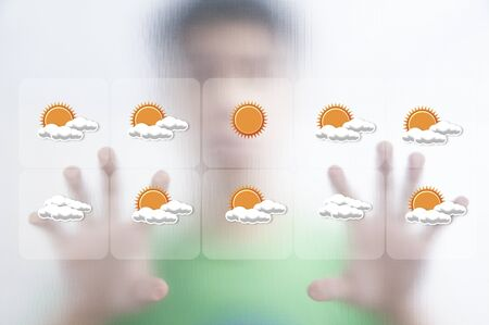 Man pushing the weather screen on transparent screen Stock Photo - 10473692
