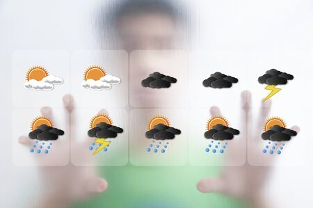 Man pushing the weather screen on transparent screen photo