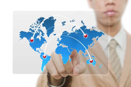 Businessman point finger on world map with ARROW Stock Photo - 10473468