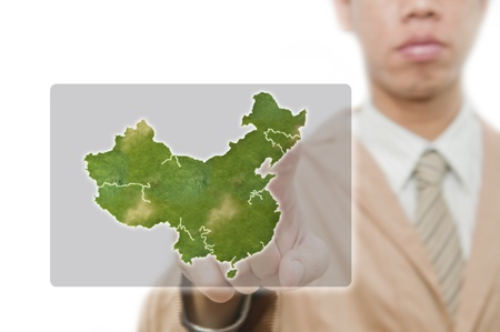 north china: Businessman point finger on china map with embeded flag