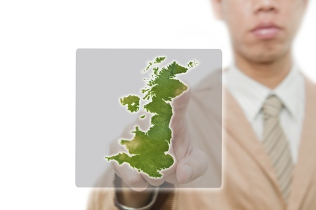 Businessman point finger on UK map with embeded flag photo